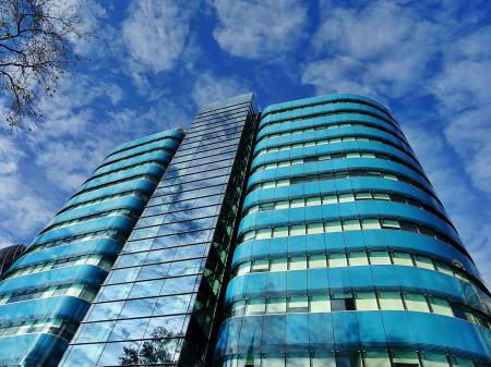 Low Angle Photography of Blue Tinted Glass Buildings