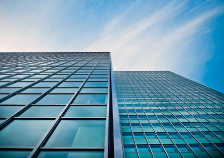 Low Angle View of Office Building Against Blue Sky