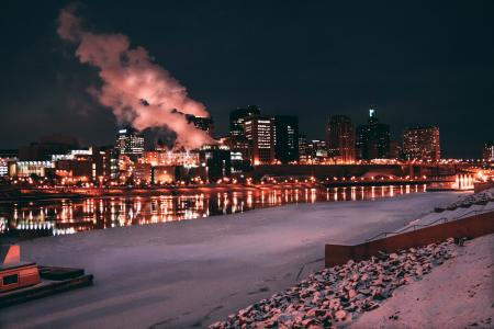 Low Light Photo of Lighted Buildings in Front of Body of Water