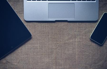 Macbook Pro Near White Iphone 5c and Black Ipad