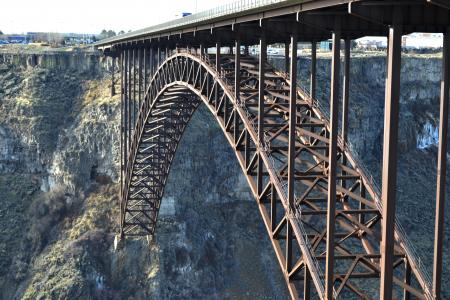 Majestic metal bridge over a huge abyss