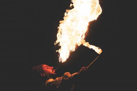 Man Blowing Fire during Nighttime