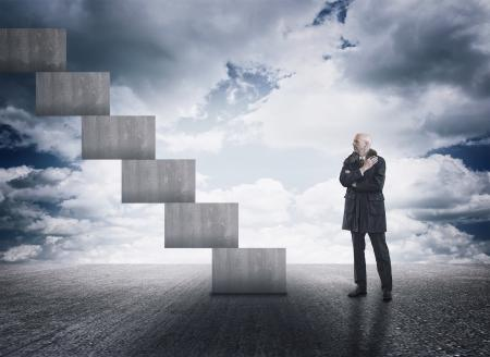 Man having doubts facing a staircase