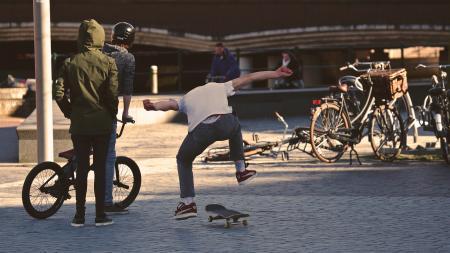 Man in White Shirt Doing Skateboard Trick