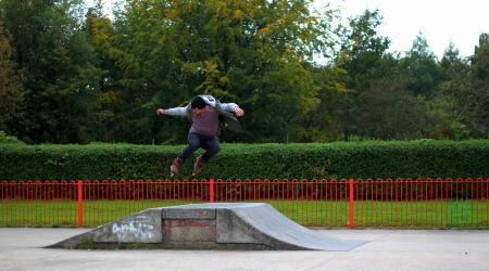 Man Jumping on Rollerskates Ramp