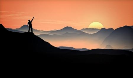 Man Raising Arm at the Top of the Mountain