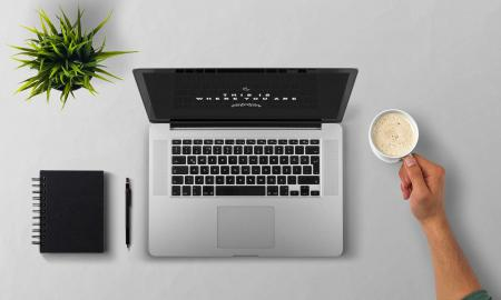 Man Using Laptop on Table Against White Background