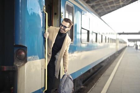 Man Wearing Beige Overcoat Inside Train