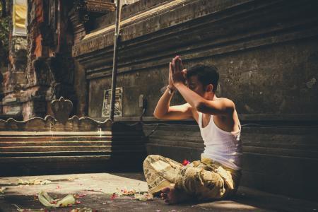 Man Wearing White Tank Top Praying