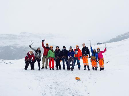 Men and Women at the Mountain Covered With Snow