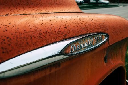 Old and rusty retro orange car