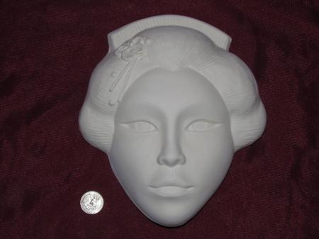 Oriental face sculpture