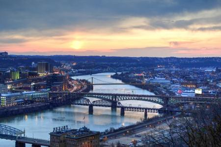 Panorama View of Suspension Bridge Connecting Urban City during Golden Hour