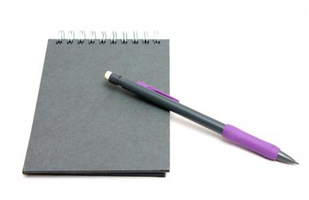 Paper and a pencil isolated