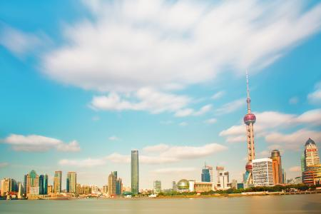 Pearl Tower Near Body of Water Under Clouds Photo Taken