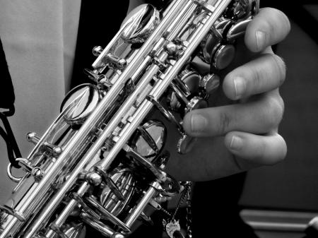 Person Holding Saxophone in Gray Scale Photography