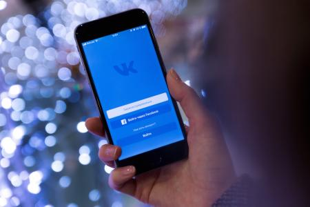 Person Holding Smartphone Displaying Vk Sign in Page