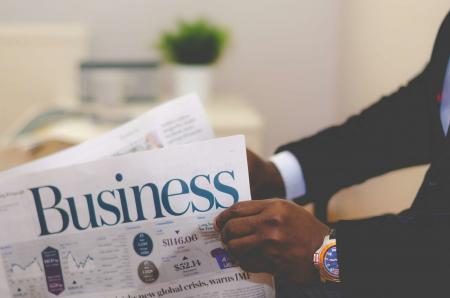 Person Holding White and Blue Business Paper