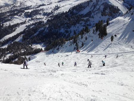 Person Riding on Snowboard on the Snow during Daytime