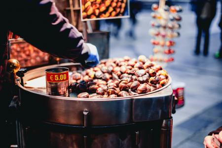 Person Selling Chestnuts