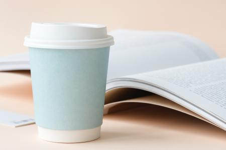 Photo of Coffee Cup Beside Book