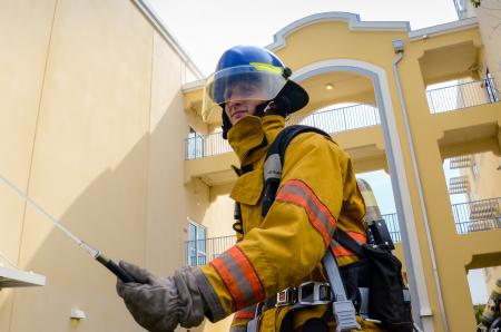 Photo of Firefighter Beside Building