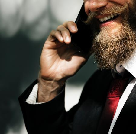 Photo of Man in Black Suit Jacket Taking a Call