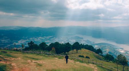 Photo of Man Walking inn the Field
