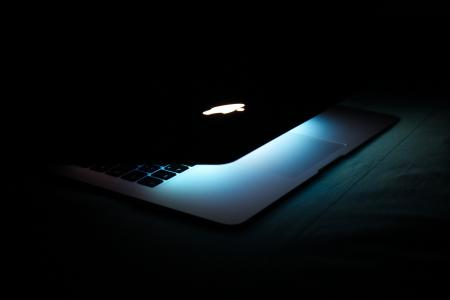 Photography of a Turned On Macbook