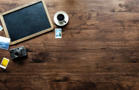 Photography of Tray, Coffee Cup and Camera on Table Top