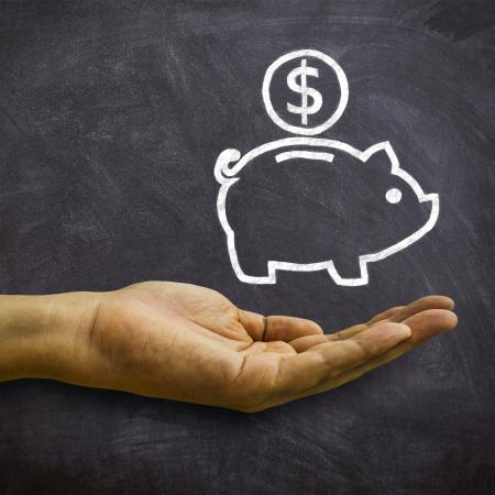 Piggy Bank on Blackboard - Savings and Economies Concept