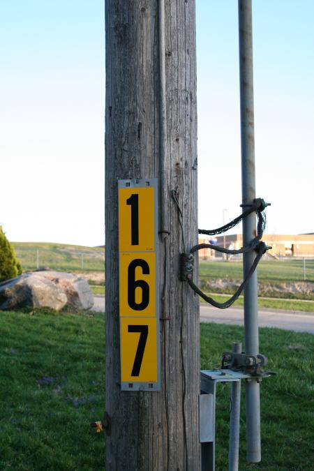 Pole with yellow sign