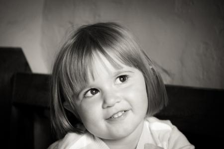 Portrait of Smiling Girl With Short Hair in Grayscale Photography