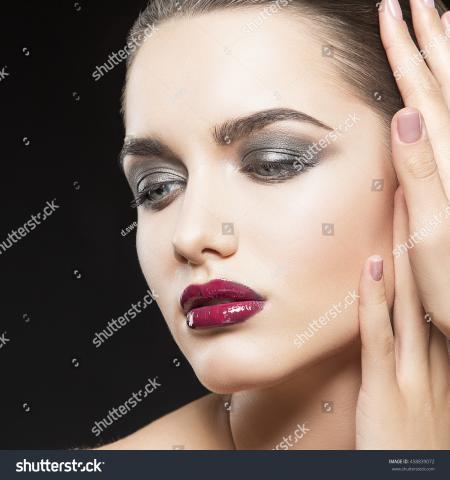 Portrait Photo of Woman's Purple Matte Lipstick
