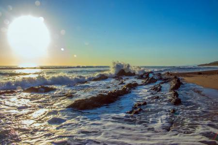 Portrait Photography of Seashore and Sun