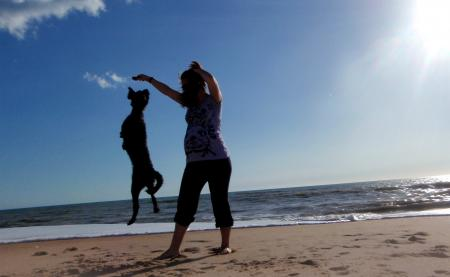 Pregnant woman playing with her dog