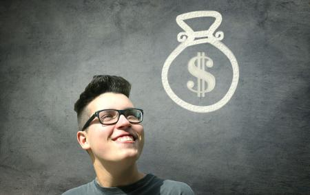 Prize Winner - Young Man Smiling with Bag of Money