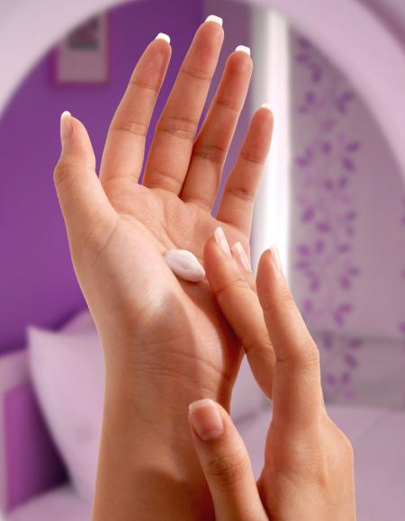 Putting Moisturizer On Her Hands
