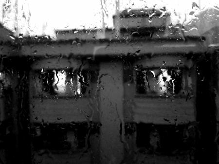 Rain Pouring on Glass Window