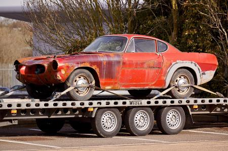 Red Coupe on Flatbed Trailer