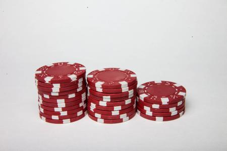 Red poker chips on white background