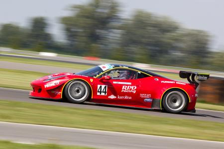 Red Racing Car on Race Track during Daytime