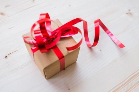 Red Ribbon on Brown Cardboard Box
