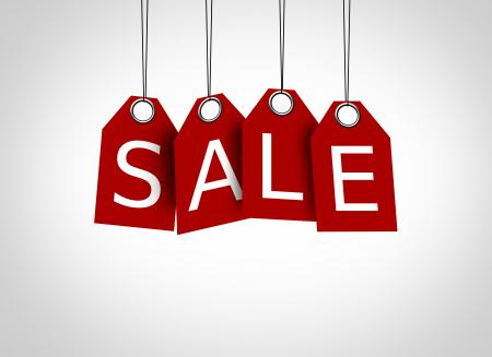 Red tags dangling with the word sale - Sales concept