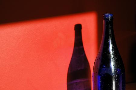 Red wall and blue bottle