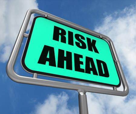 Risk Ahead Sign Shows Dangerous Unstable and Insecure Warning