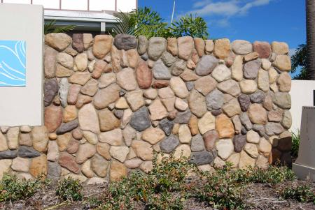 River stone wall