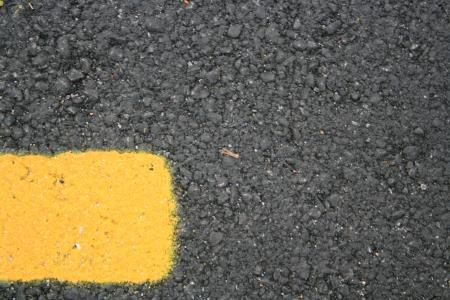 Road asphalt with yellow line