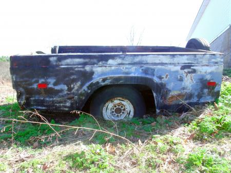 Rusted detached truck bed