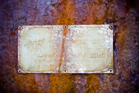 Rusted Sign on Metal Background